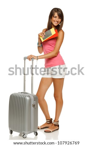 Full length of young female in casual standing with travel bag, holding passport and tickets, isolated on white background - stock photo