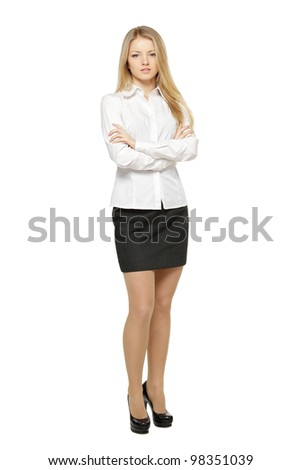 Full length of young female standing with folded hands, isolated on white background - stock photo