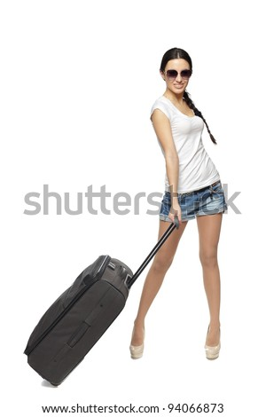 Full length of young female standing with the travel bag, isolated on white background