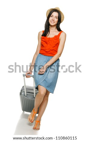 Full length of young female walking with travel suitcase, isolated on white background - stock photo