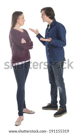 Full length of young man fighting with woman over white background