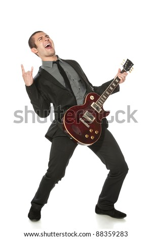 Full length of young man in a suit with guitar over white background