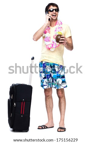 Full length of young man with travel bag - stock photo