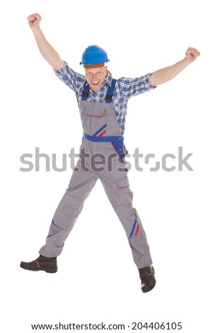 Full length of young manual worker screaming with hands raised over white background - stock photo