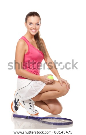 Full length of young tennis woman sitting in the squatting position, on white background - stock photo
