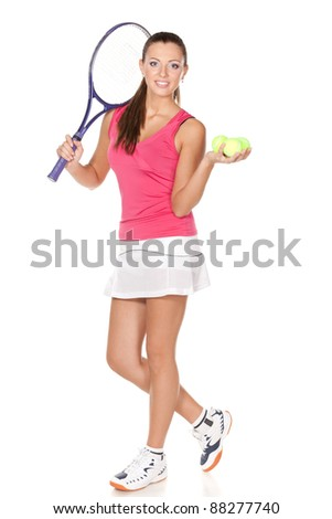 Full length of young woman holding racket and ball isolated on white background - stock photo