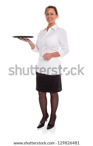 Full length photo of a waitress holding an empty tray, isolated on a white background. Suitable product placement image to add your own item. - stock photo