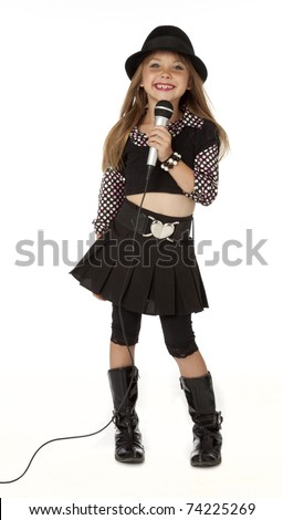 Full length photo of cute little girl holding microphone. White background. - stock photo