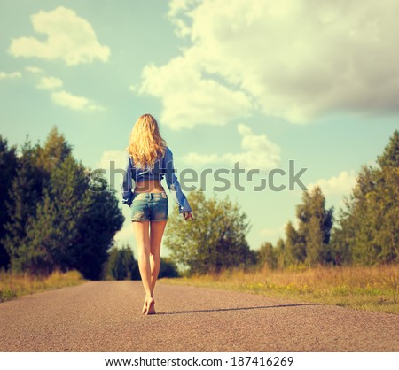 Full Length Photo of Sexy Blonde Woman Walking Away. Toned Photo. Trendy Street Style. - stock photo