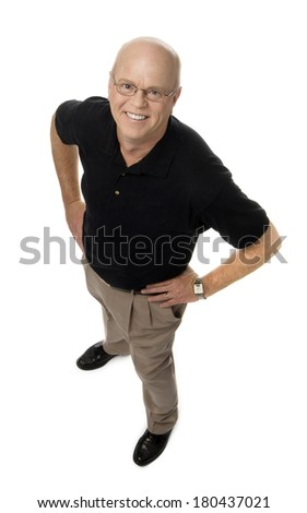 Full length photo of smiling mature man, hands on hips, standing on white background. - stock photo
