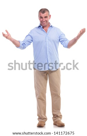 full length picture of a casual senior man welcoming you with a smile. isolated on white background - stock photo