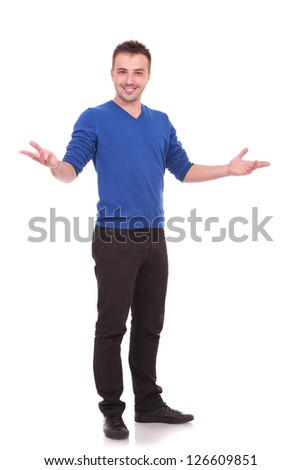 Full length picture of a young casual man welcoming you on white background - stock photo