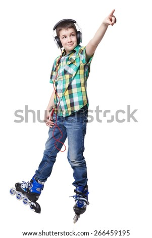 Full length portrait a boy on rollers pointing up sign isolated on white