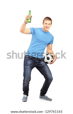 Full length portrait an euphoric fan holding a beer bottle and cheering isolated on white background - stock photo