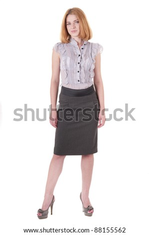 Full-length portrait beautiful lookind down young woman in blouse and skirt on white