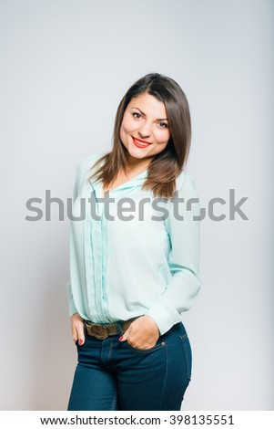 Full length portrait closeup of a young beautiful business woman smiling, vertical - stock photo