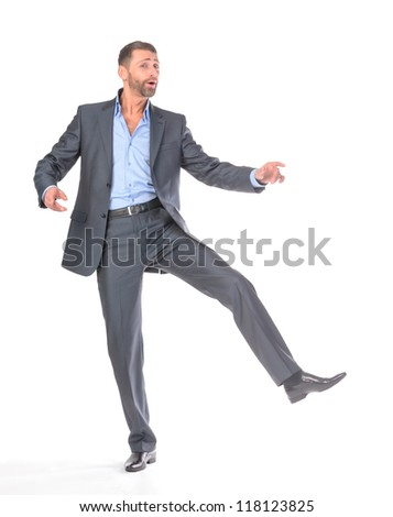 Full length portrait dancing businessman, over white background