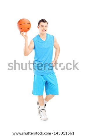 Full length portrait of a basketball player holding a basketball and posing isolated on white background - stock photo