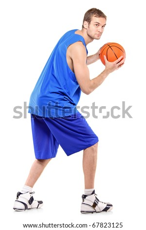 Full length portrait of a basketball player posing with a ball isolated against white background - stock photo