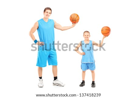 Full length portrait of a basketball players posing isolated on white background - stock photo