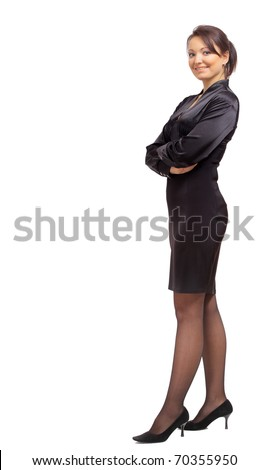 Full length portrait of a beautiful business woman standing with hands folded over white background - stock photo