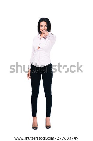 Full length portrait of a beautiful businesswoman pointing finger at camera. Isolated on a white background - stock photo