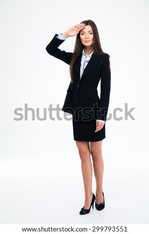 Full length portrait of a beautiful businesswoman saluting isolated on a white background - stock photo