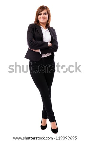 Full length portrait of a beautiful businesswoman standing with crossed arms and legs isolated on white background - stock photo