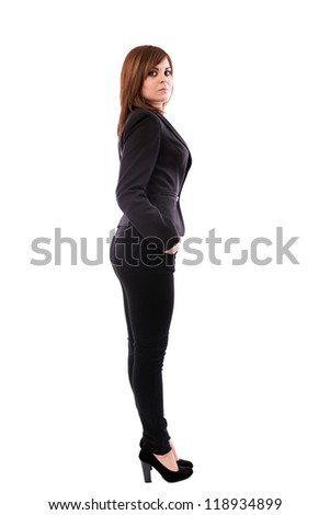 Full length portrait of a beautiful businesswoman standing with hands in pockets isolated on white background
