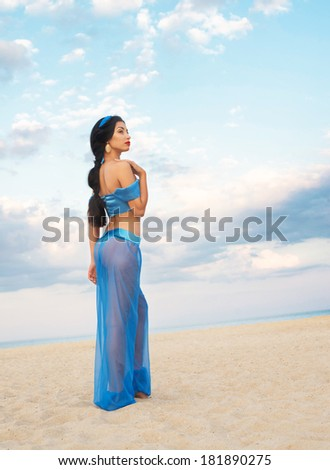 Full length portrait of a beautiful girl in belly dance costume - stock photo