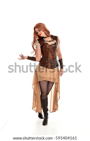 full length portrait of a beautiful girl wearing steampunk outfit, standing pose isolated on white background.