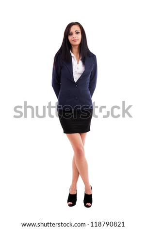 Full length portrait of a beautiful latin businesswoman standing with crossed legs isolated on white background