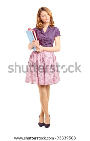 Full length portrait of a beautiful school girl holding books isolated on white background - stock photo