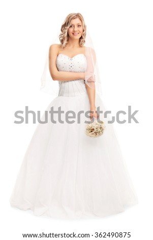 Full length portrait of a beautiful woman in a white wedding dress holding a flower and looking at the camera isolated on white background