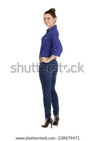 Full length portrait of a beautiful woman in blue jeans and shirt, isolated on white