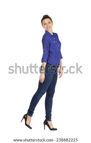 Full length portrait of a beautiful woman in blue jeans and shirt, isolated on white - stock photo