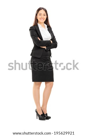 Full length portrait of a beautiful woman in formal clothes posing isolated on white background
