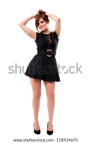 Full length portrait of a beautiful woman wearing black dress isolated on white background - stock photo