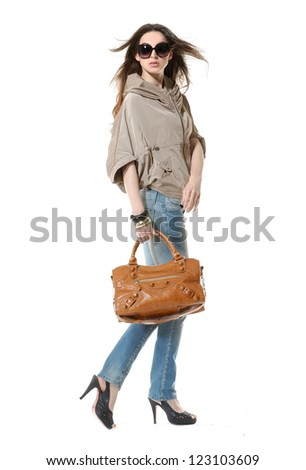 Full length portrait of a beautiful woman with bag on white background - stock photo