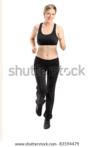 Full length portrait of a blond female running isolated on white background