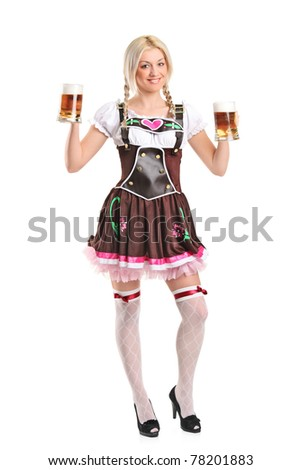 Full length portrait of a blond woman with traditional costume holding beer glasses isolated on white background - stock photo