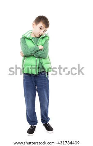 Full length portrait of a bored little boy with arms folded isolated on white - stock photo