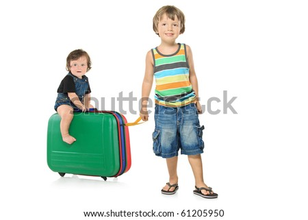 Full length portrait of a boy pulling a suitcase with a baby girl on it isolated on white background - stock photo
