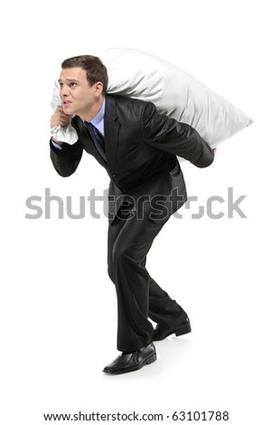 Full length portrait of a businessman carrying a money bag isolated against white background - stock photo