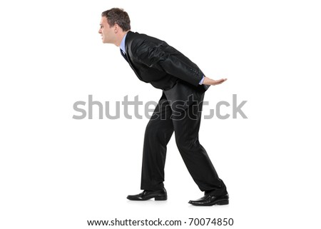 Full length portrait of a businessman carrying something imaginary isolated on white background - stock photo