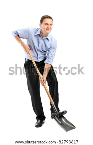 Full length portrait of a businessman  holding a shovel isolated on white background - stock photo