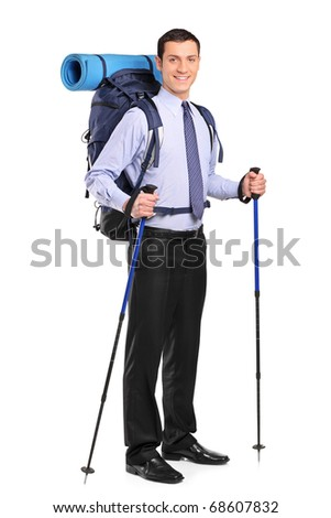 Full length portrait of a businessman in a suit with backpack and hiking poles isolated on white background - stock photo