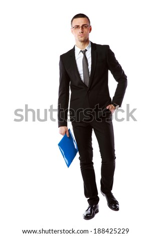 Full length portrait of a businessman in glasses with blue folder over white background - stock photo
