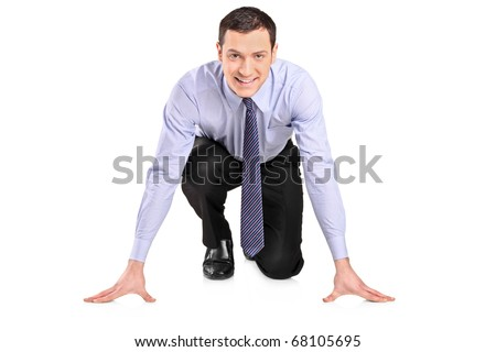 Full length portrait of a businessman ready to run, looking at camera, isolated on white background - stock photo
