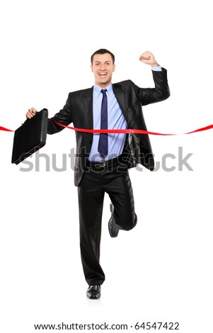Full length portrait of a businessman running at the finish line isolated on white background